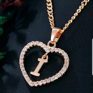 New gold tone letter I necklace